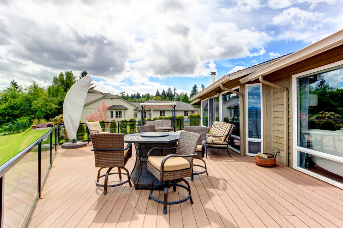 Screened walkout deck with fire pit, chais, bench and garden swing