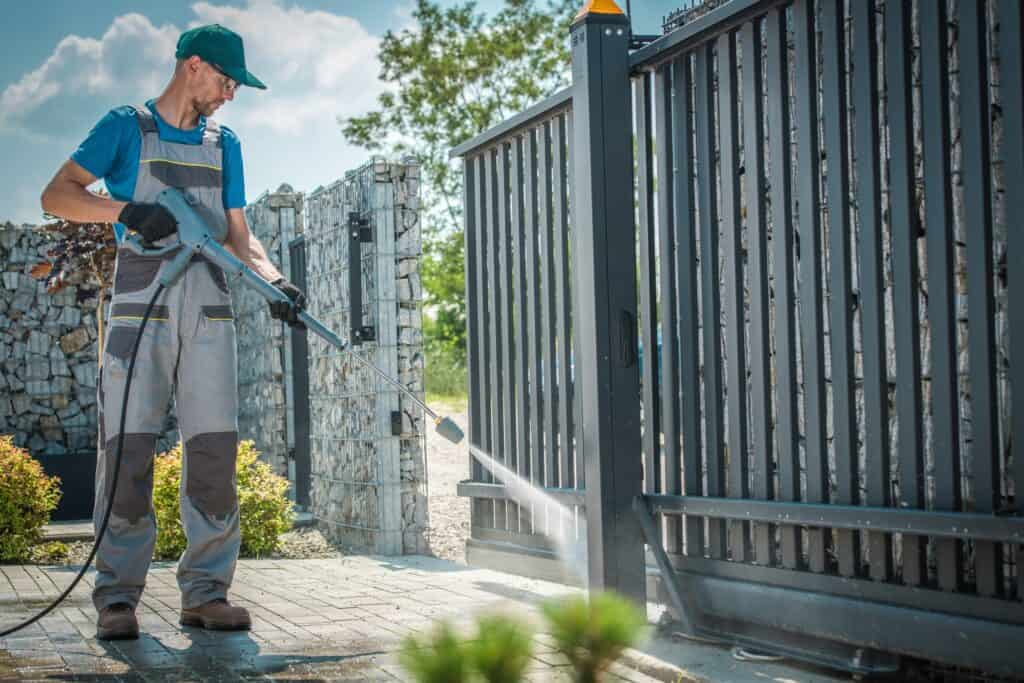 House Driveway and the Gate Pressure Washing by Caucasian Men