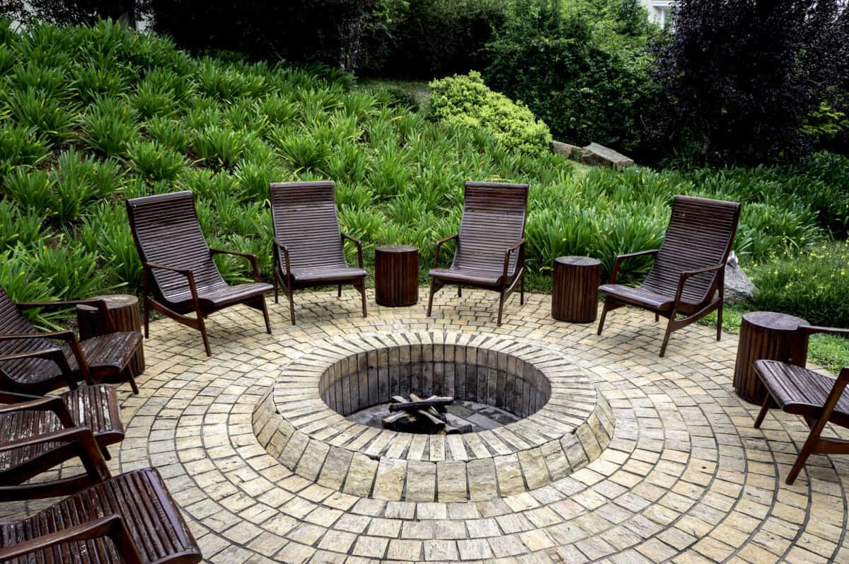 Fire pit on patio with rustic backyard chair