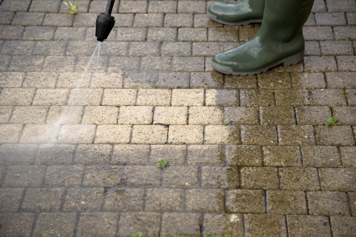Outdoor floor cleaning with power washer pressure washer