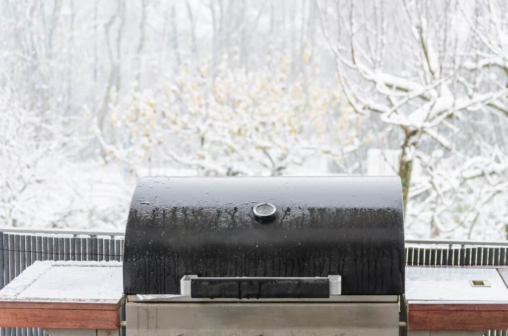 BBQ on the outside balcony in the winter snowstorm.