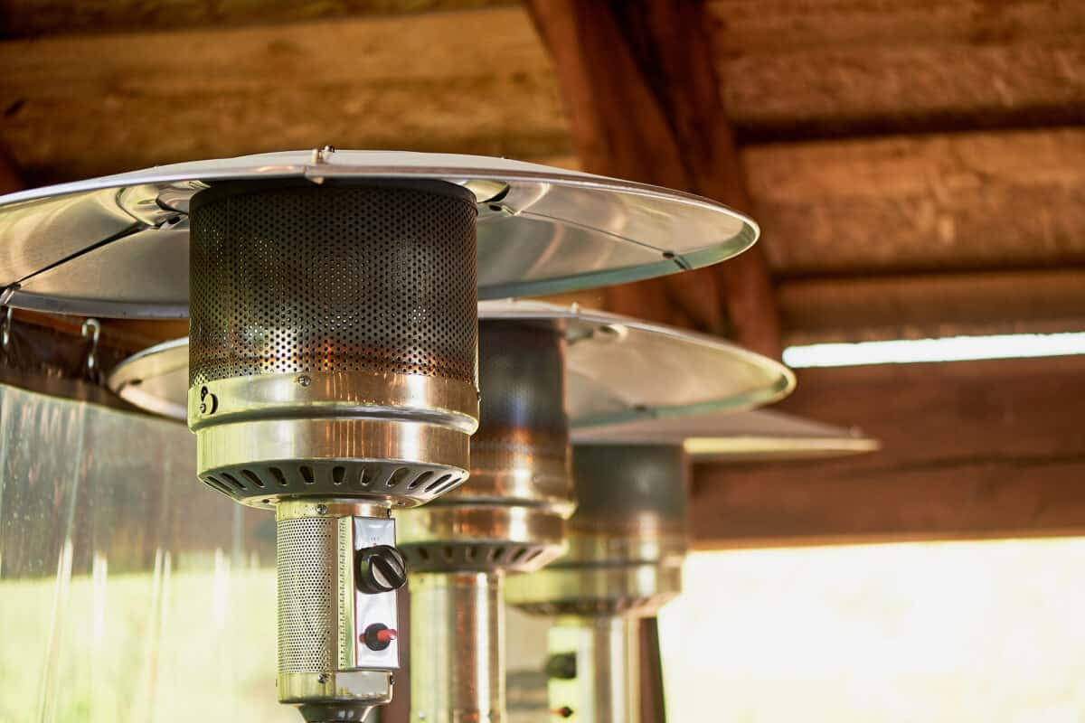 Preventing patio heaters from tipping over by lining them up in storage