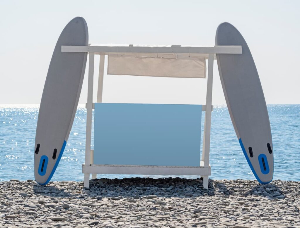Two paddleboards leaning on a tall storage rack