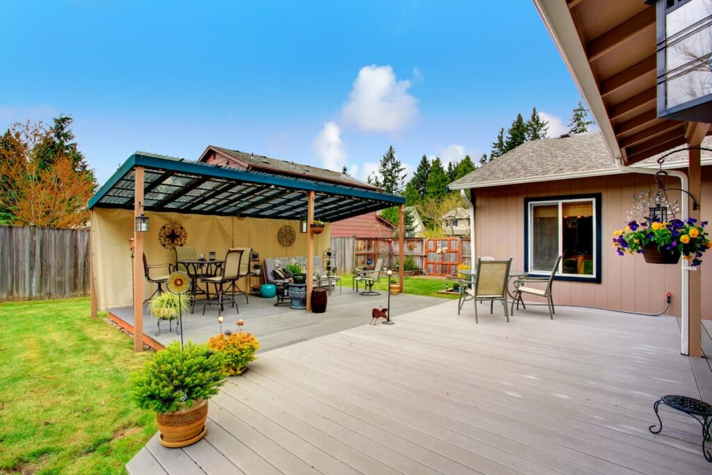 Backyard walkout deck with a pergola facing the direction of the deck